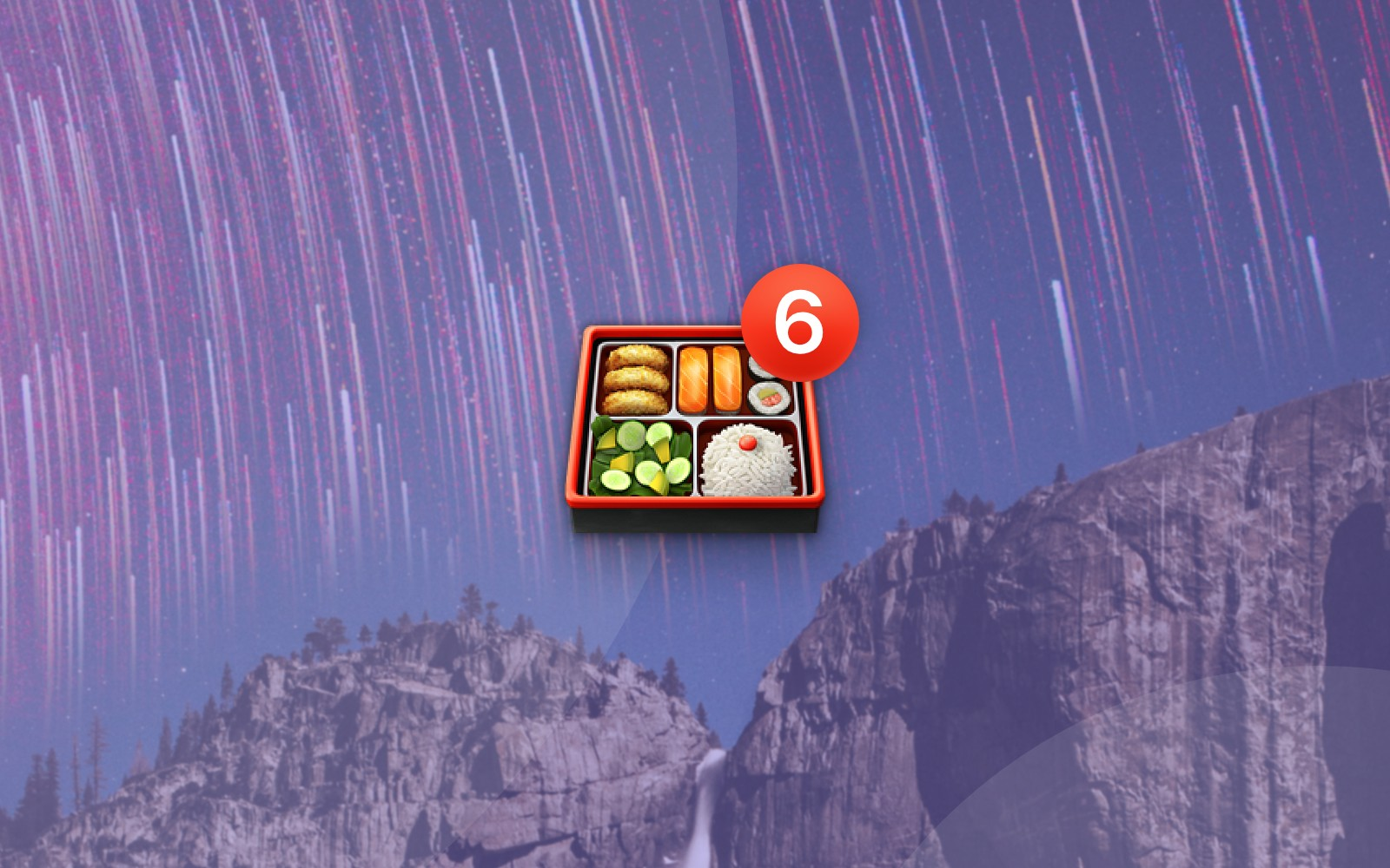 Bento box emoji with number 6 badge on mountainside with stars background