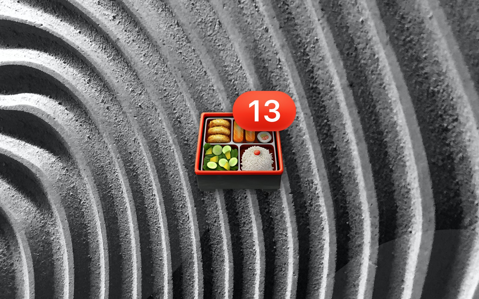 Bento box emoji with number 13 badge resting on a grayscale textured wavy background