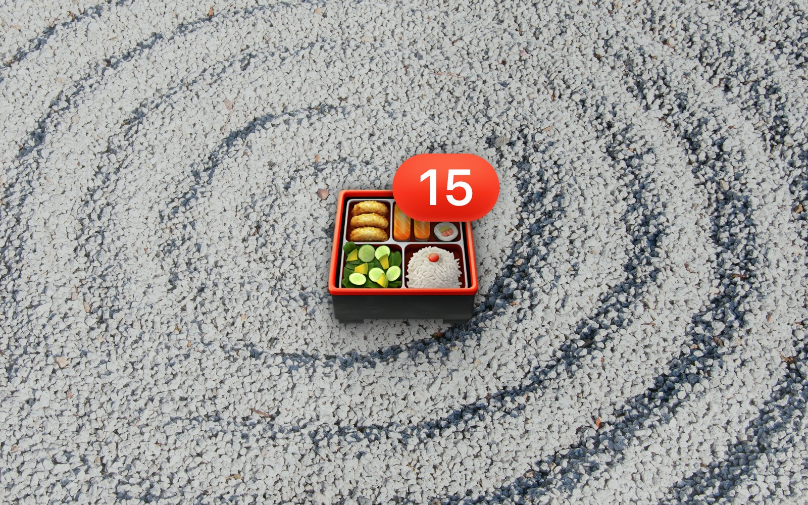 Bento box emoji with number 15 badge resting on a grayscale rock wave