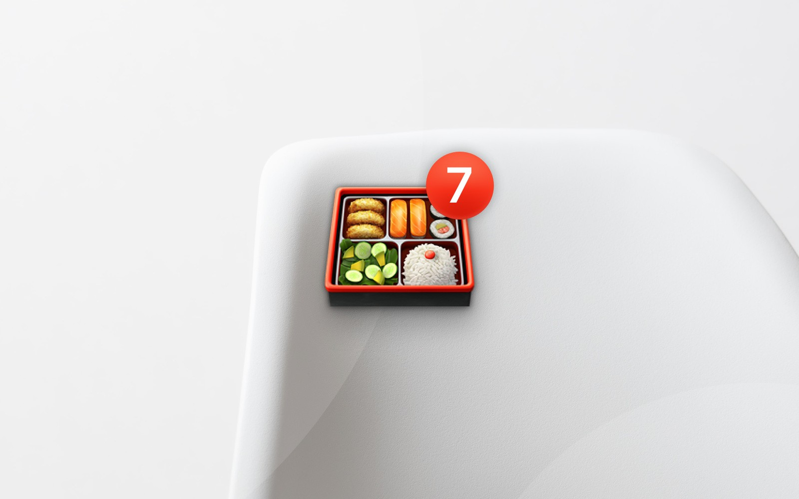 Bento box emoji with number 7 badge on mountainside with abstract white background