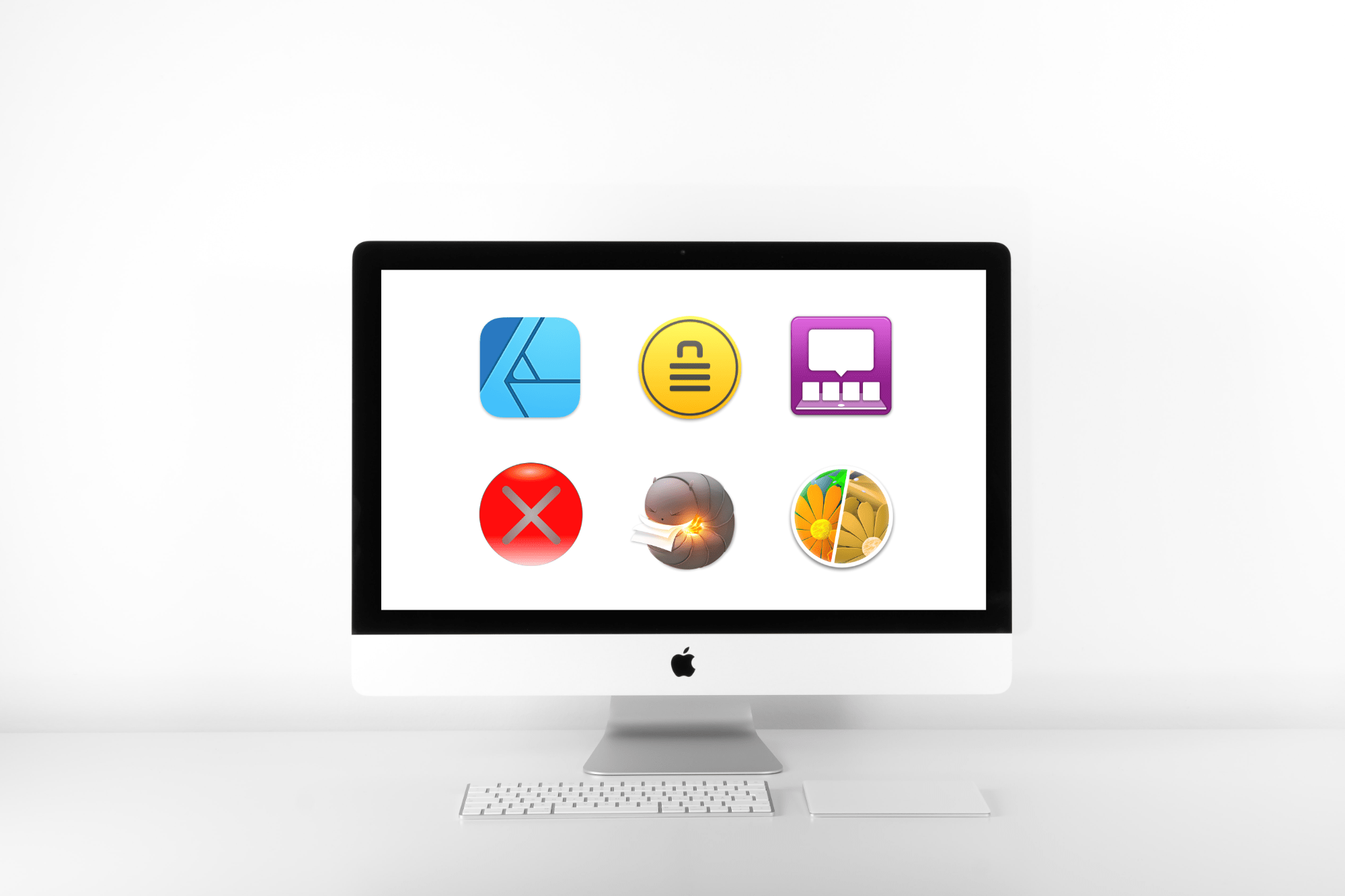 Mac monitor in white room with a white desktop displaying app icons featured in the associated article